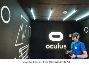 Augmented and virtual reality represented by a man wearing glasses and seeing digital world