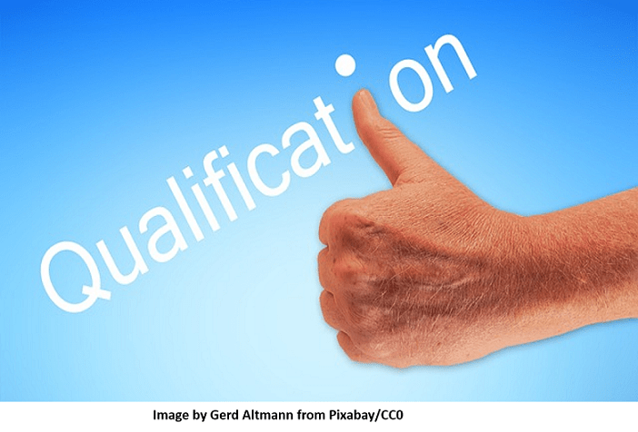 Qualification shown with thumb on a blue back ground